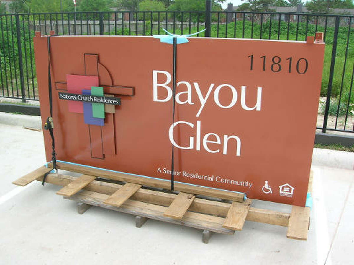 The sign for the new-and-opening soon Bayou Glen Housing.