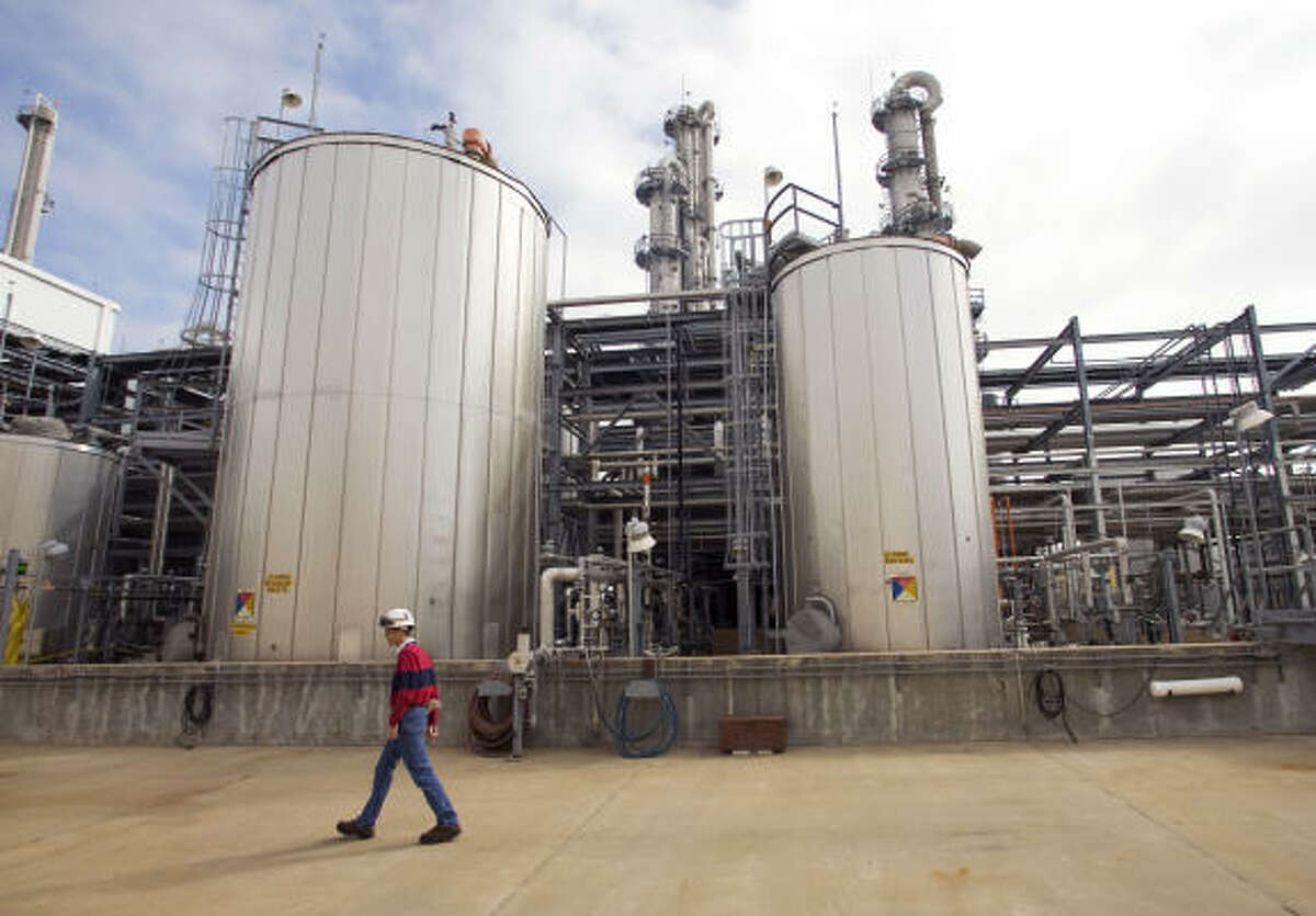 Todd Spengeman, operations manager, walks past a storage facility for intermediate product at the BASF chemical plant near Freeport in December.
