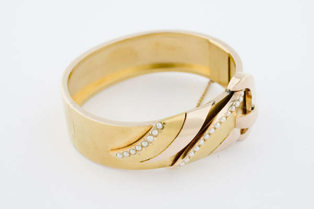 GIVE YOUR SWEETIE JEWELRY: Such as an 18 karat yellow and rose-gold bracelet.