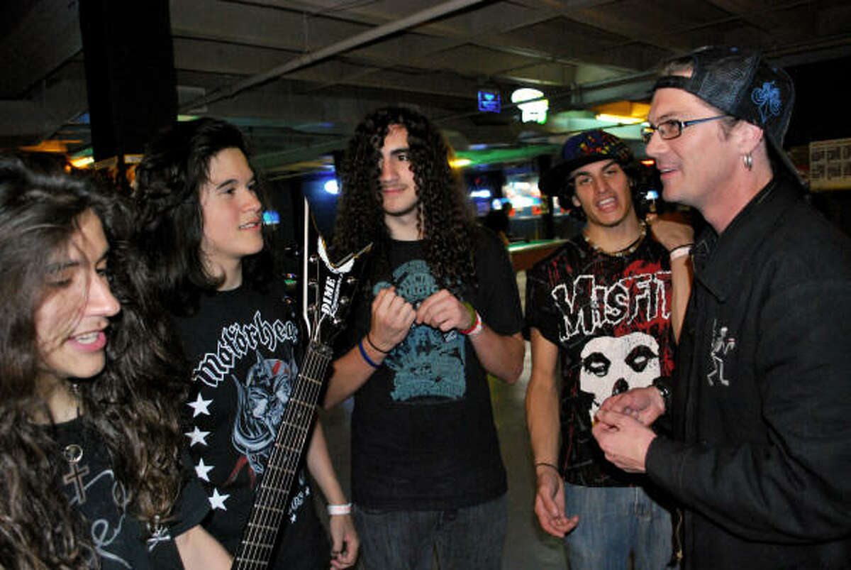 Metavenge members Anthony Cruz, from left, Brandon Galvan, Chris Richardson and Tony Bastida talk metal strategy with Keri Kelli, who produced six songs for the young Houston group, before a show at the Meridian. Kelli is the longtime guitarist for Alice Cooper.