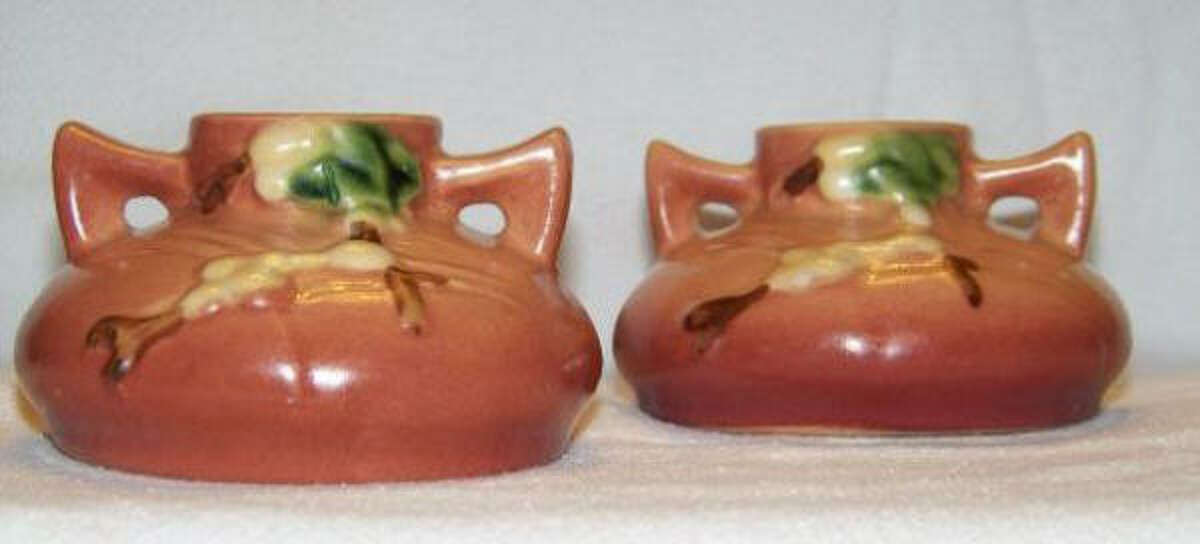 A GLOWING VALUE: A pair of candlesticks, created by Roseville Pottery, would probably be worth $125 to $225.