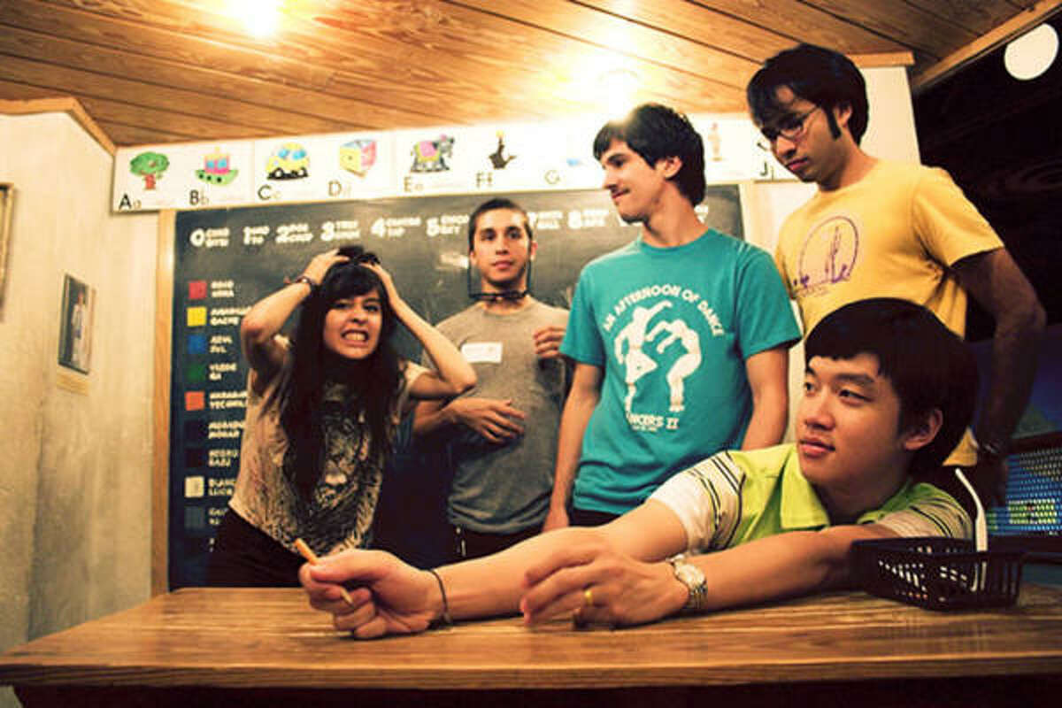 The Wild Moccasins (Zahira Gutierrez, from left, Andrew Ortiz, Cody Swann, Nick Cody and Andrew Lee) will spend the next month together on the road, much of that time crammed in a van.