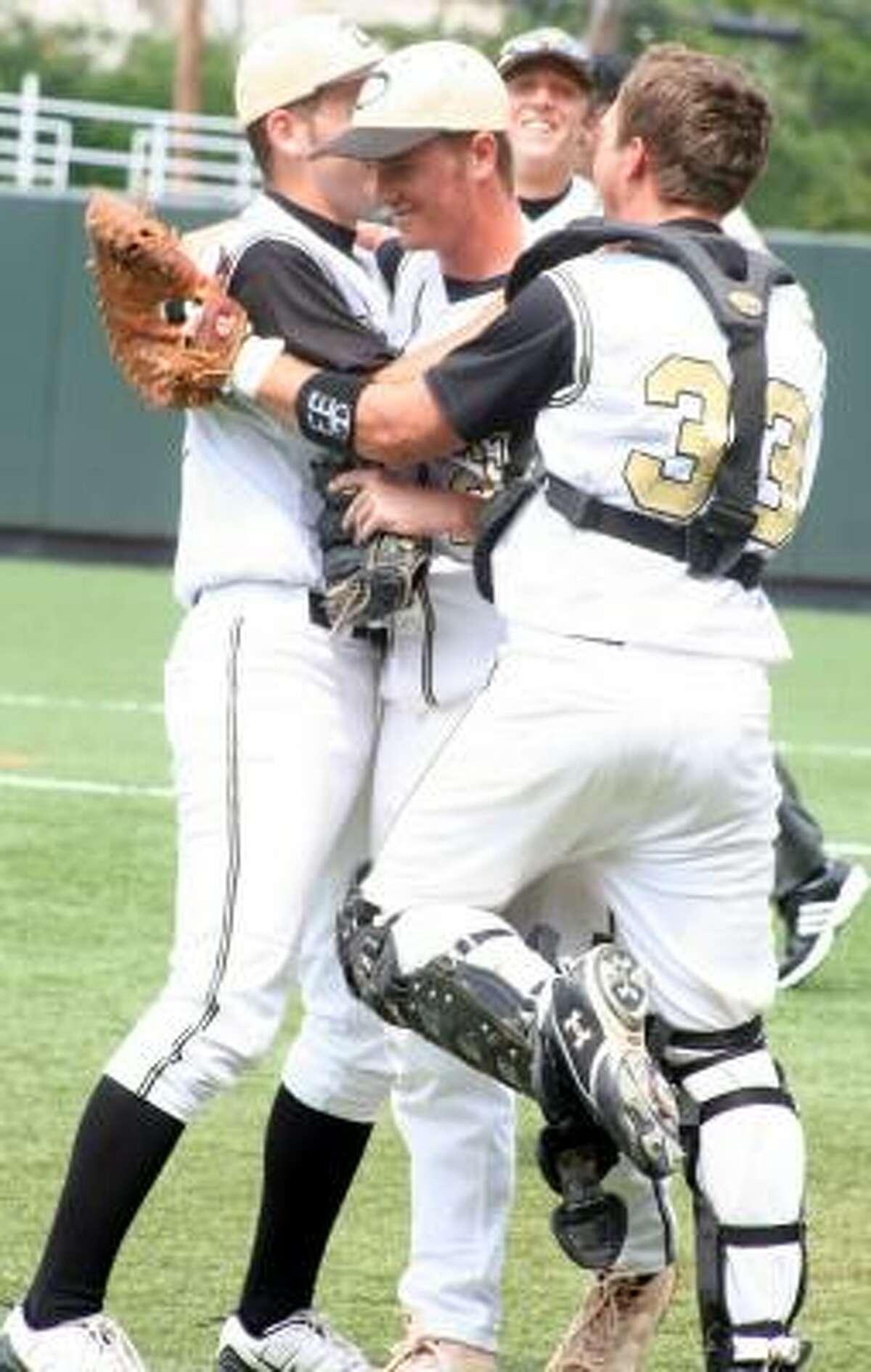 Danbury catcher Trey Noak hugs pitcher Matt Dees after he got the save.