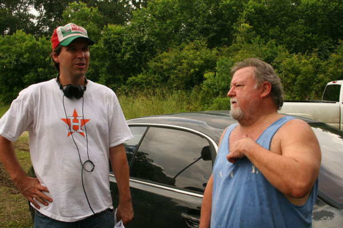 Writer-director David Pomes, left, works with actor Rutherford Cravens on the set of Cook County during filming near Cleveland.