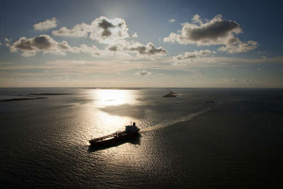 Ship traffic through Galveston Bay and into the Gulf of Mexico has largely recovered nearly a year after Hurricane Ike, but the picture for the bay's waters and wildlife remains murky. Photo: Smiley N. Pool, Chronicle