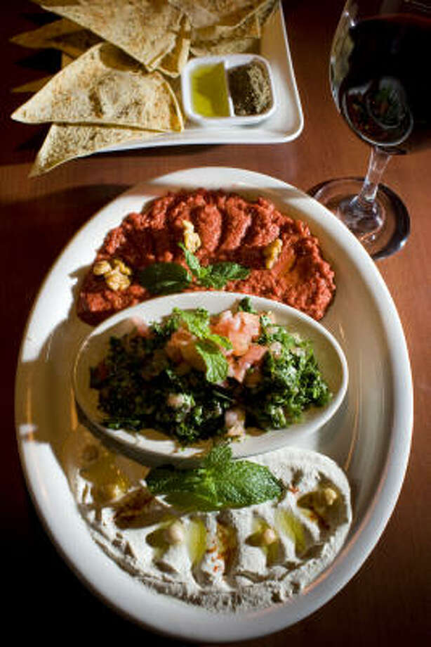 The Pick Three appetizer at Cafe Mezza offers some of the best menu items at the Syrian restaurant on Westheimer. Photo: Johnny Hanson :, Chronicle