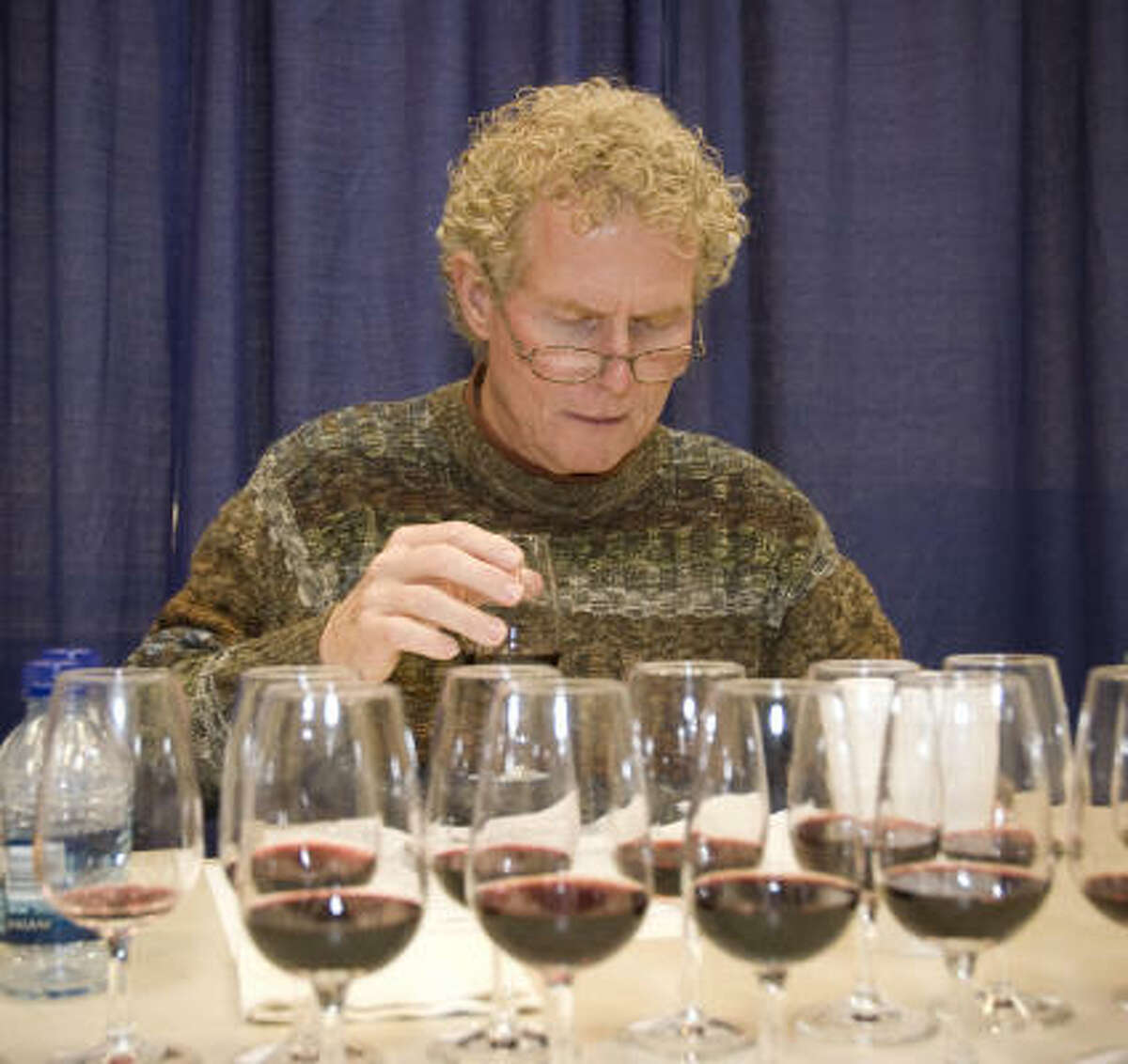 Dale Robertson samples different wines for the International Wine Competition.