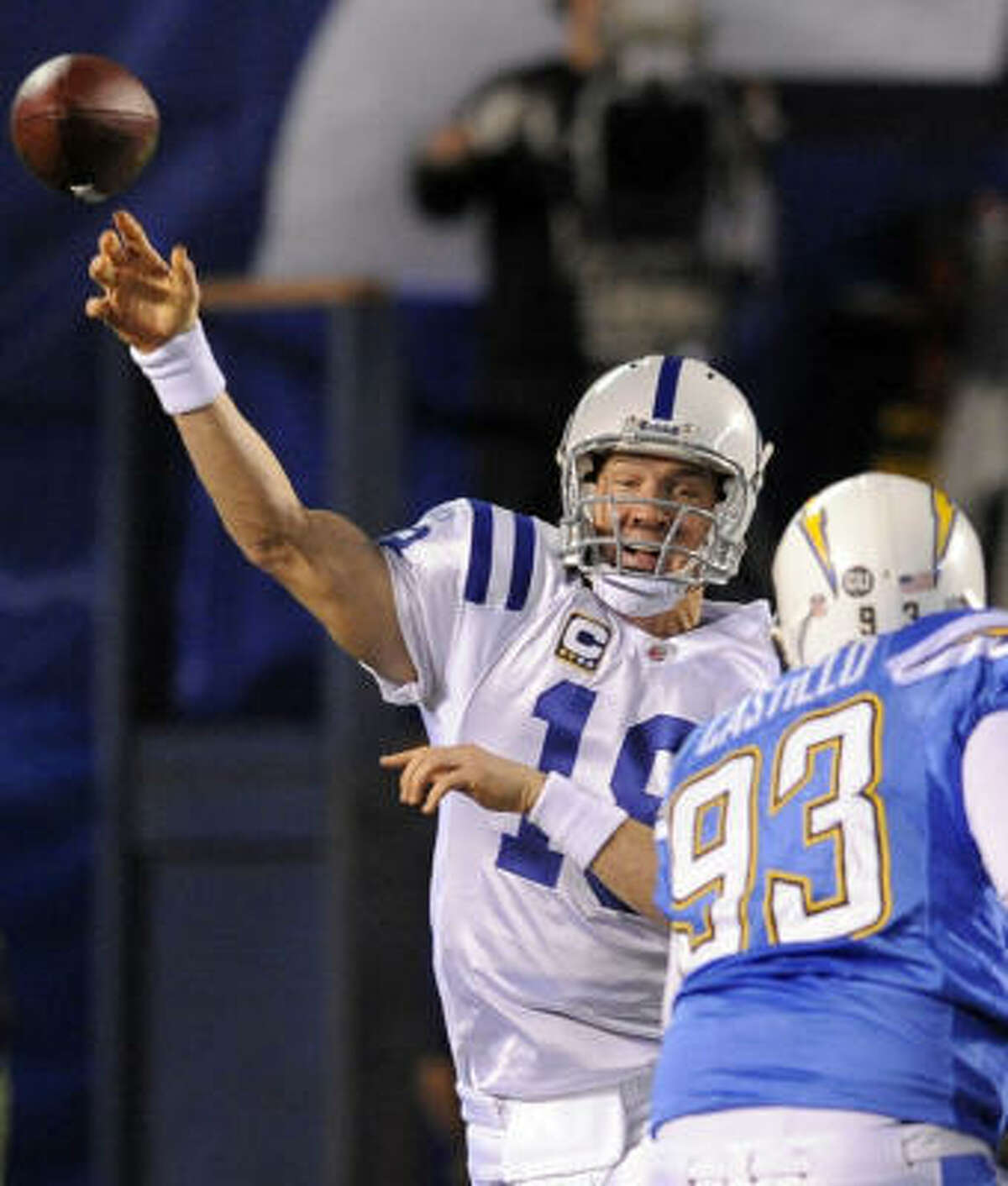 Indianapolis Colts quarterback Peyton Manning, left, throws over San Diego Chargers defensive tackle Luis Castillo during the first quarter.