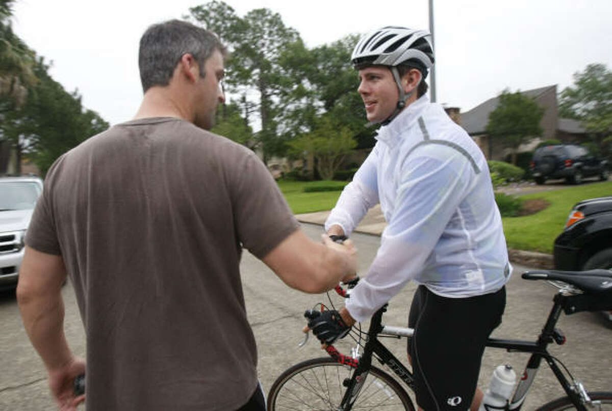 Mike Kruft decided to take off on his own Saturday after rain delayed the BP MS 150, leaving his car with Jeff Betters, left, of Katy. The first leg officially starts Sunday in La Grange.