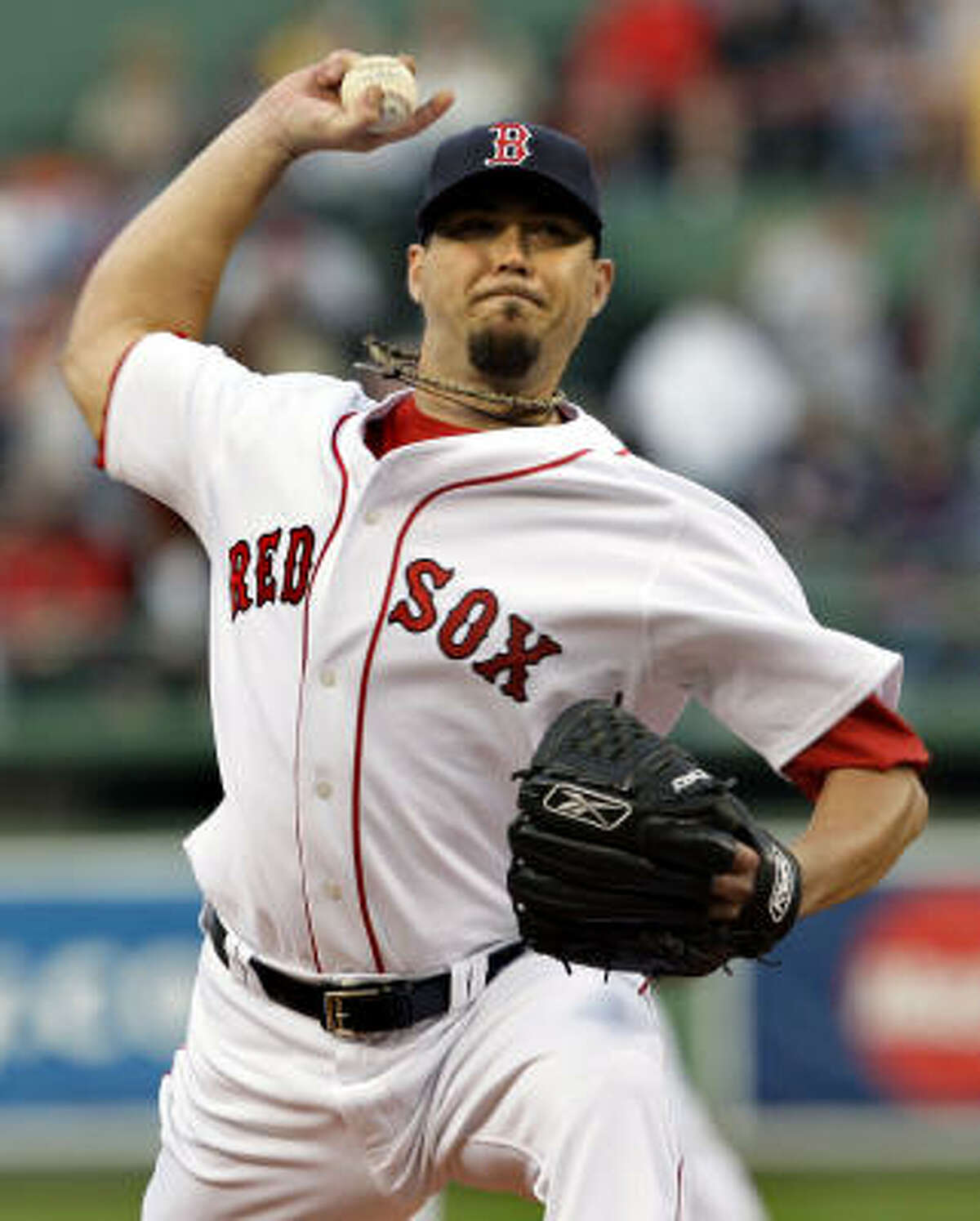 Red Sox starter Josh Beckett delivers to the Athletics in the first inning of their game Tuesday at Fenway Park.