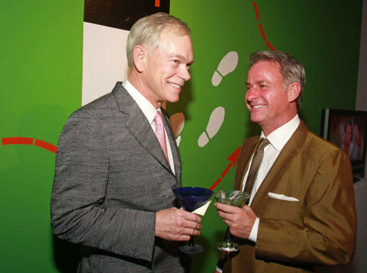 Jay Jones, left, and Terry Wayne Jones joined the mid-century mode as chairs of the Houston Center for Contemporary Craft Martini Madness benefit.