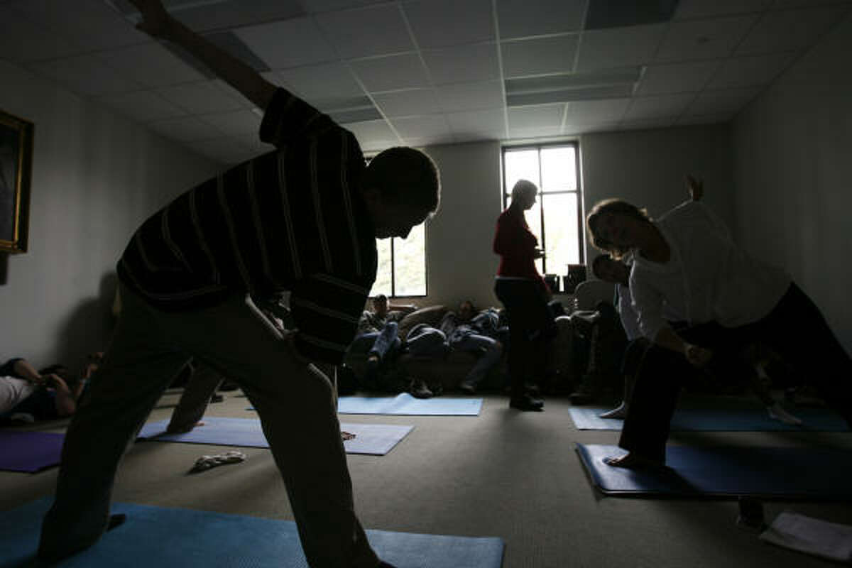 """Students practice yoga in their physical education class. """"Our policy is, we don't expect you to be perfect, but we expect you to be honest,"""" said Sasha McLean, Archway's executive director."""