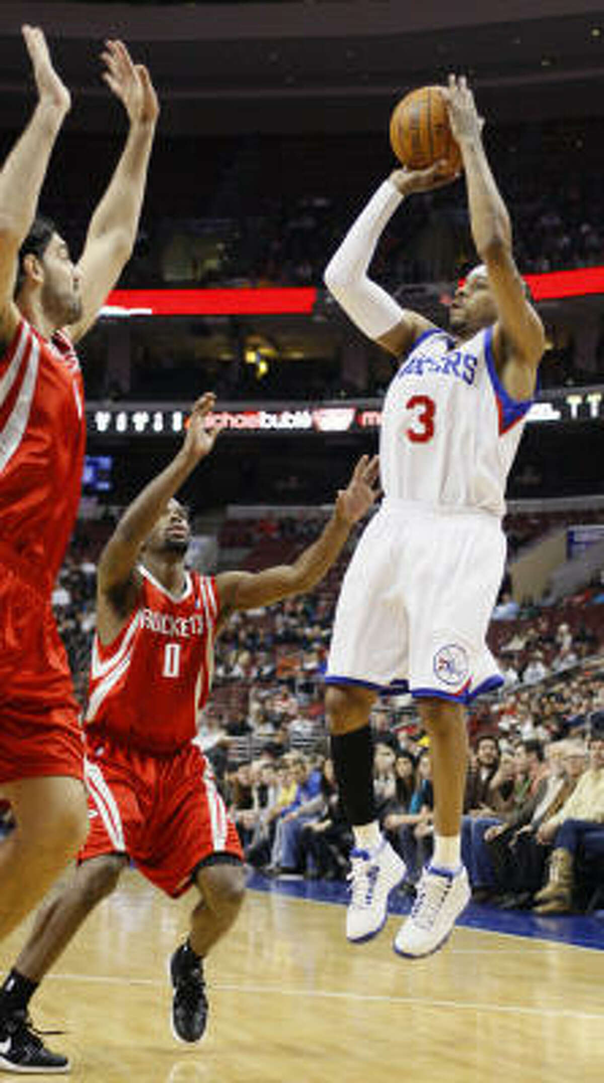 76ers guard Allen Iverson, right, goes up for a shot as Aaron Brooks (0) and Luis Scola defend.