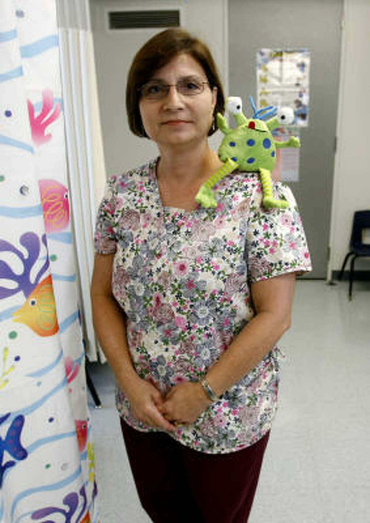 """School nurse Charlotte Greer and """"Mr. Snot"""" teach elementary students how flu germs spread."""