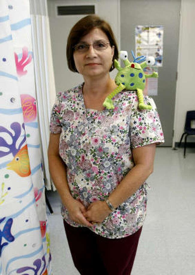 "School nurse Charlotte Greer and ""Mr. Snot"" teach elementary students how flu germs spread. Photo: Karen Warren, Chronicle"