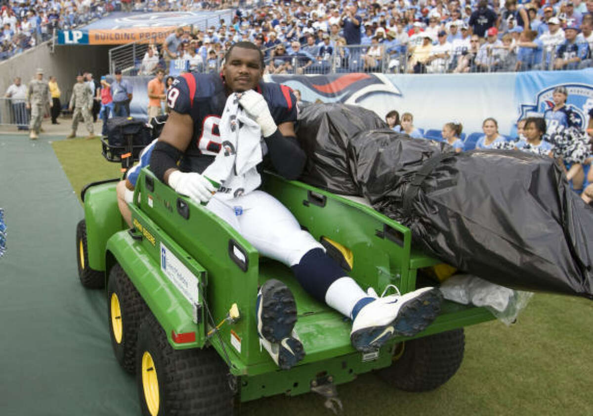 Texans offensive tackle Chester Pitts is carted off the field after suffering a knee injury during the second quarter.