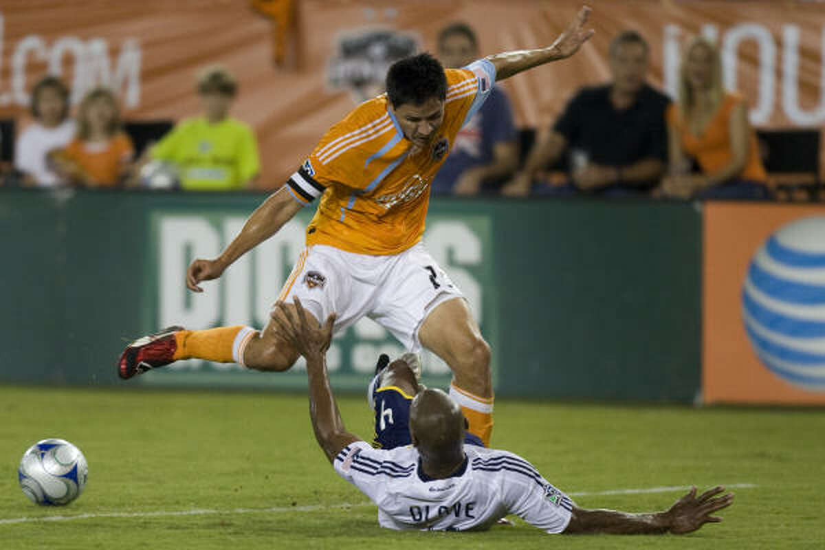 Dynamo forward Brian Ching will remain with the team through 2013 thanks to a new contract.