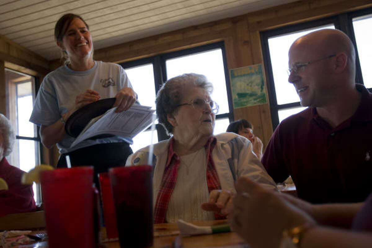 TIME TO CELEBRATE: Brad Vratis, at right, the son of the owner of Stingaree Restaurant, talks with his grandmother, Betty Carlisle of Cleveland, during lunch on Thursday. At left is waitress Marie Schulz.