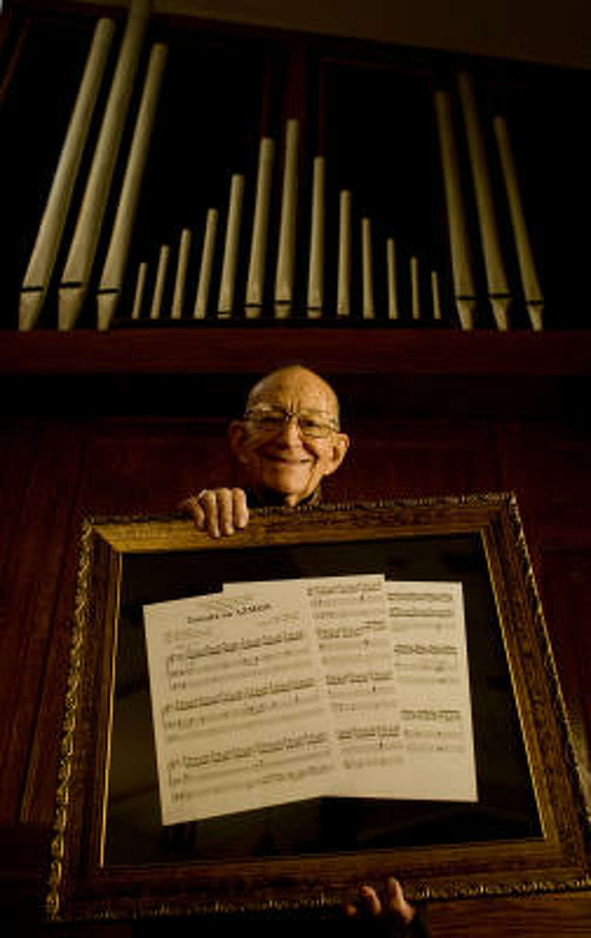 M.W. Ford, 91, with the sheet music for Toccata on Azmon, arranged by Jerry Westenkuehler in honor of Ford's 70 years as organist at First United Methodist Church in Dayton.