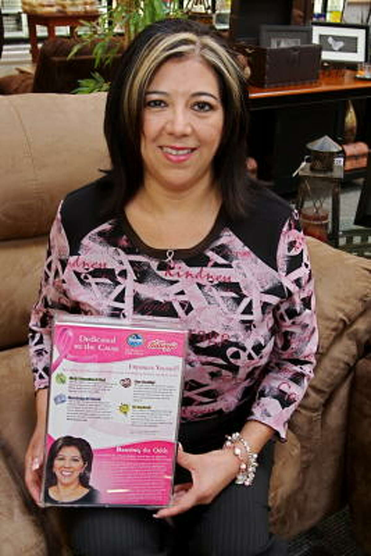 Cecilia Sarabia, manager at the Kroger Marketplace in Richmond, is a breast cancer survivor. Sarabia holds a Special K cereal box where her photo appears on the back of the box.