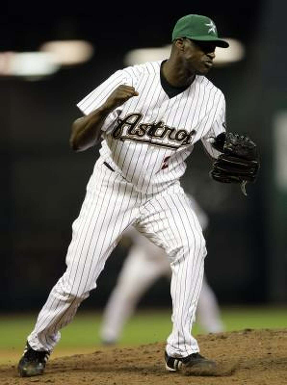 Astros pitcher LaTroy Hawkins reacts after striking out Orlando Hudson to end the game.