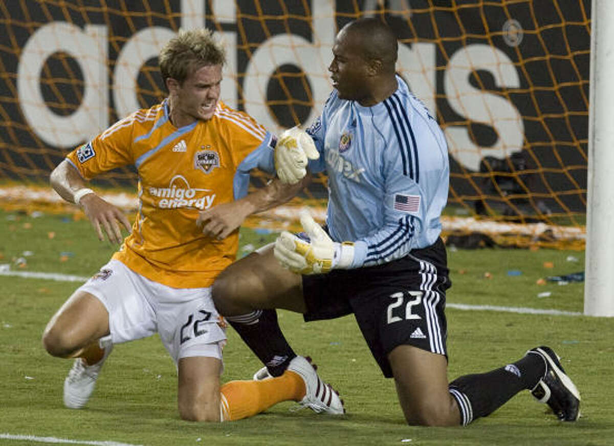 Dynamo's Stuart Holden, tangling with Chivas USA goalkeeper Zach Thornton, scored for the Dynamo.