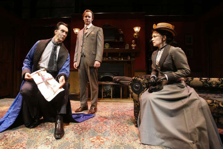 Todd Waite, left, stars as Sherlock Holmes, Chris Hutchinson plays Watson, and Elizabeth Bunch plays Irene St. Claire. Photo: Julio Cortez, Chronicle
