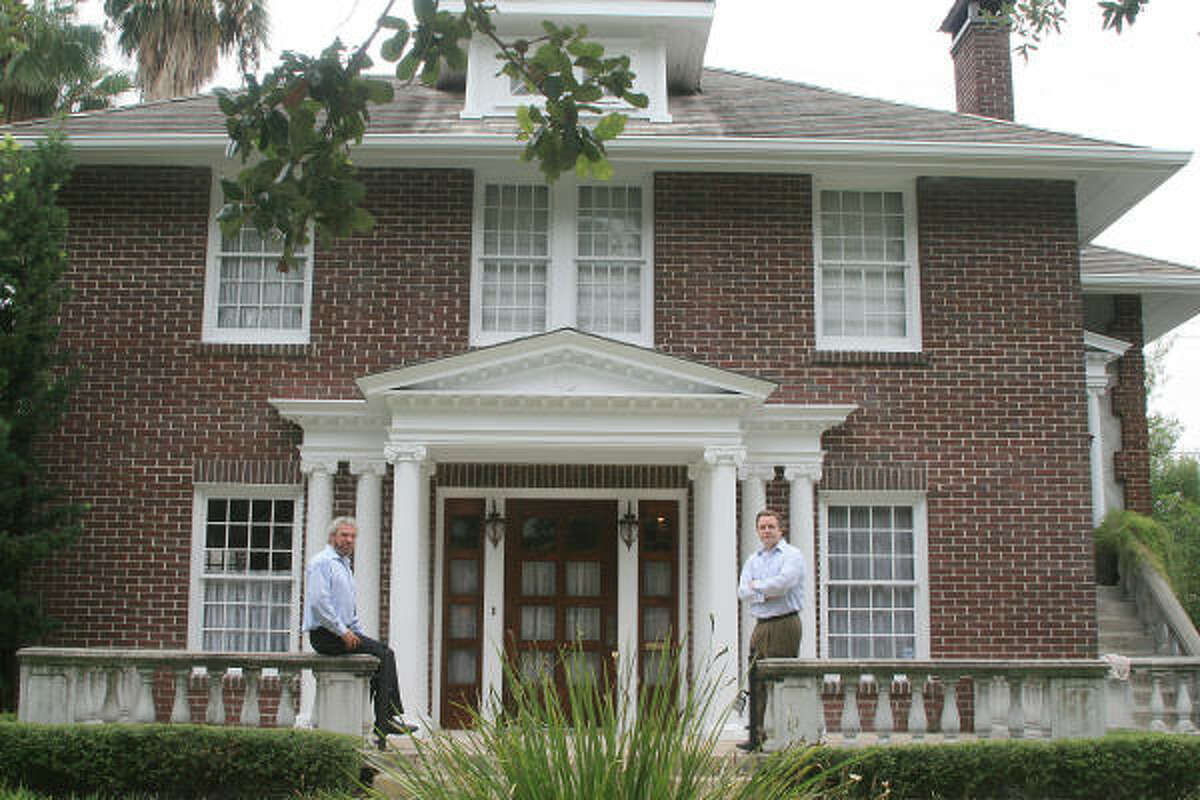 Tim Womble and Patrick Banks in front of one of the Avondale houses.
