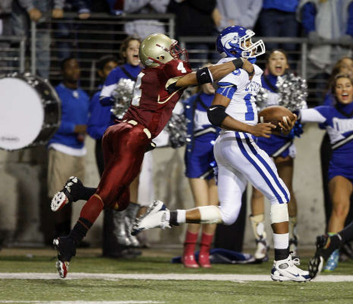 Cy Creek quarterback Chucky Keeton is caught from behind by Cy Woods' Bryce Callahan.