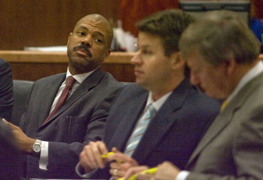 Former Texas state Rep. Borris Miles, (left) shown earlier this week with his attorneys, Derek Hollingsworth (center) and Rusty Hardin, was acquitted of deadly conduct on Thursday. Photo: James Nielsen, Chronicle