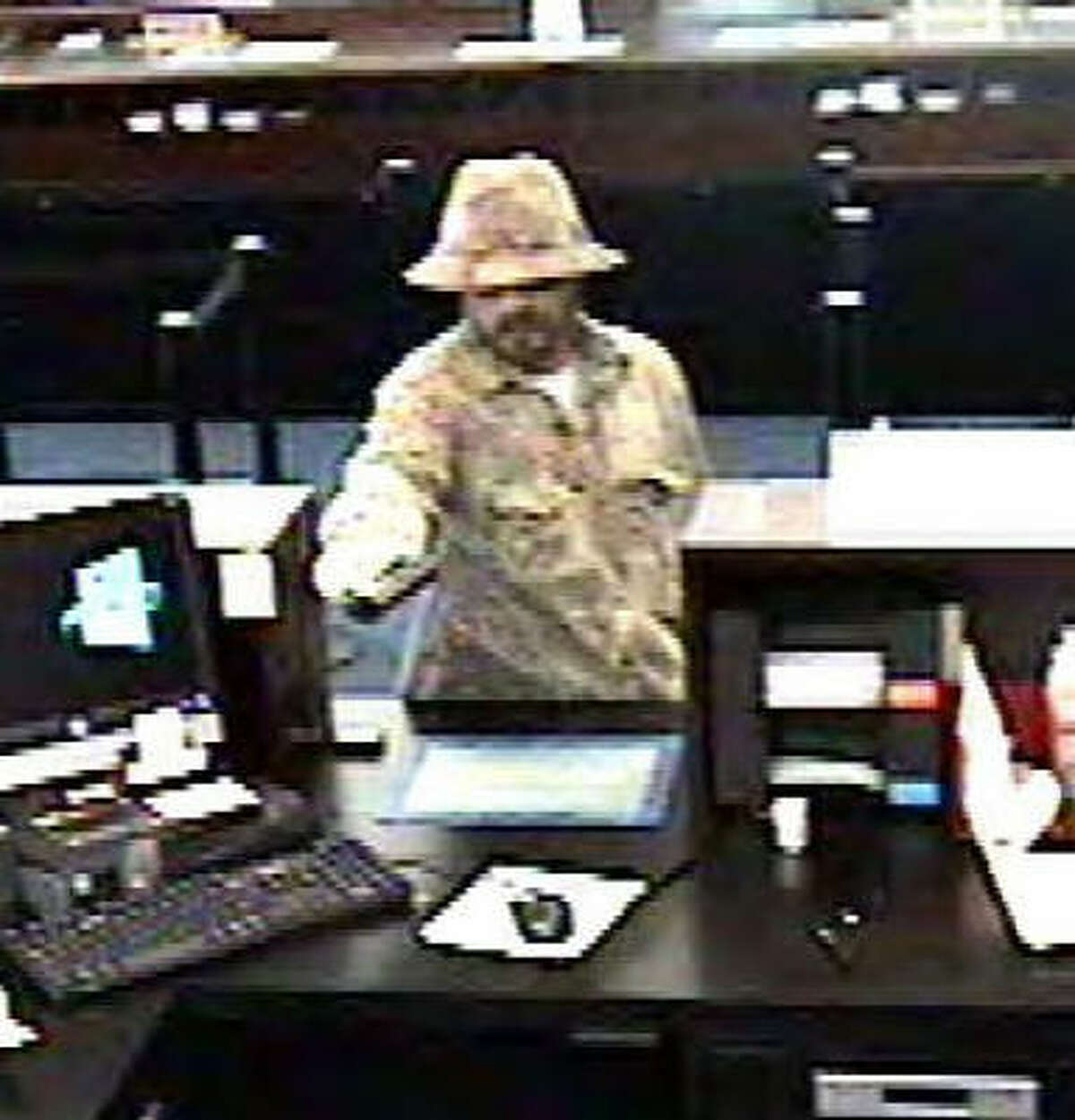 The man in this photo robbed Chase Bank, 8201 Kuykendahl Road, on Feb. 20. Authorities said they believe this robbery and three others in southern Montgomery County might be linked.