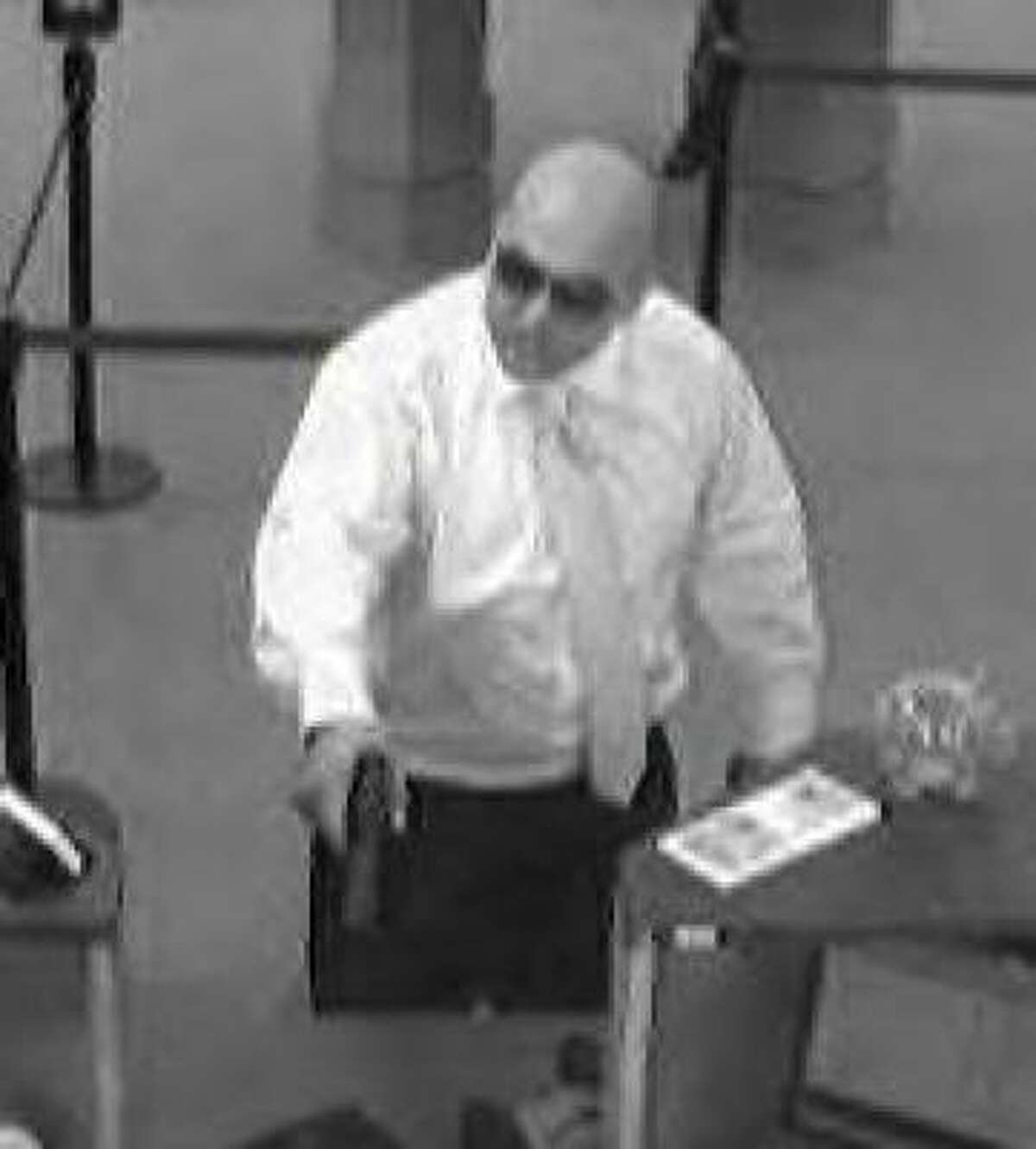 The man in this photo robbed Wells Fargo Bank, 4880 West Panther Creek, on March 5. Authorities said they believe this robbery and three others in southern Montgomery County might be linked.
