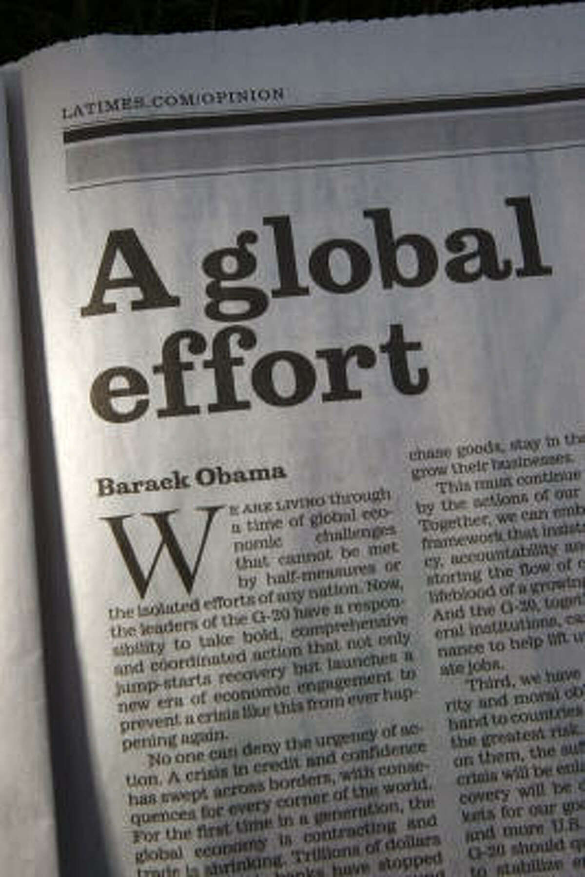 In a column printed in 31 newspapers worldwide, President Barack Obama urges world leaders to join together and take