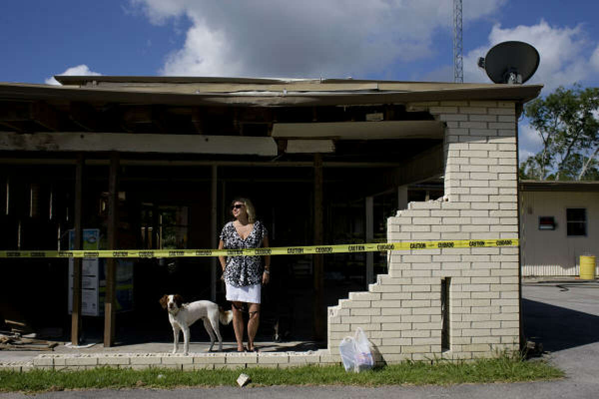 Brit Johnson's house was among the Shoreacres homes devastated by Hurricane Ike. Johnson said its appraisal dropped by thousands of dollars. Shoreacres is facing a financial crisis because its property tax base has fallen almost 23 percent.