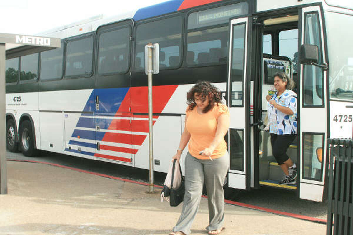 TAKING THE BUS: Janice Rivera and Mary Rojas exit to the Pasadena Park and Ride bus at the end of a work day July 22.