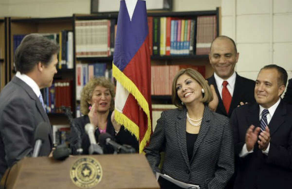 Houston judge Eva Guzman, with Gov. Rick Perry, is replacing Scott Brister on the Texas Supreme Court.