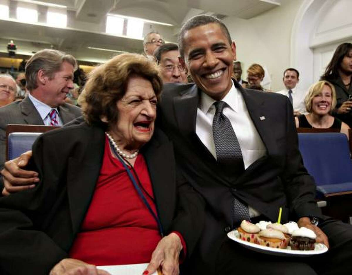 President Barack Obama and White House reporter Helen Thomas shared a birthday moment on Aug. 4. The president turned 48 and Thomas turned 89.