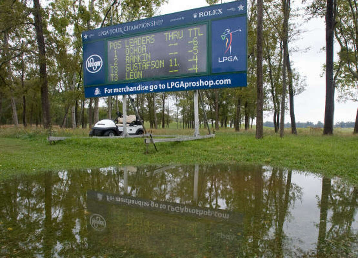 Water gathers at a leader board near the fourth green at The Houstonian Golf and Country Club.