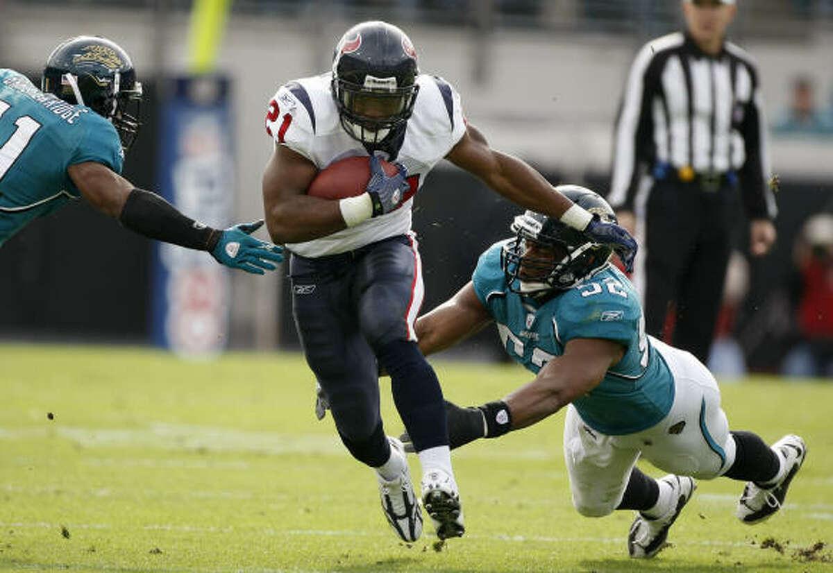 Texans running back Ryan Moats looks for running room against the Jaguars.
