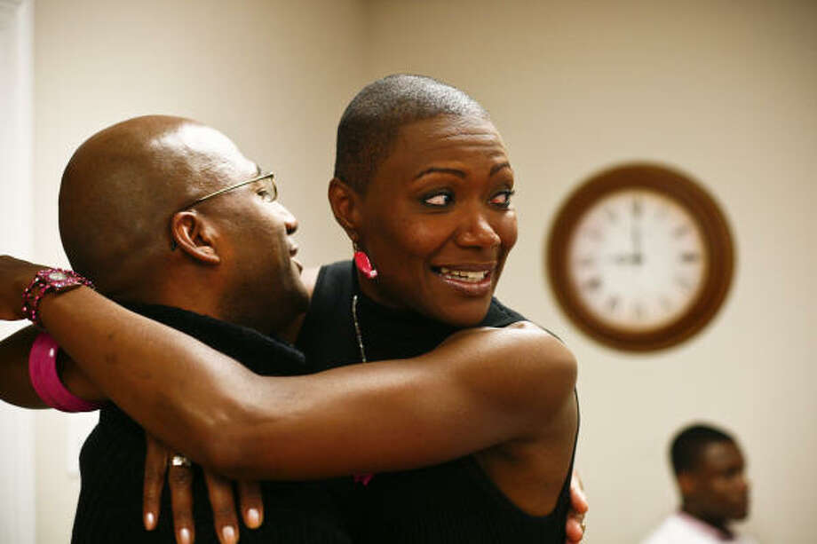 City Councilwoman Jolanda Jones hugs supporter Michael Harris while watching the election returns at her headquarters on Saturday night. She won by less than 1,700 votes. Photo: Michael Paulsen, Chronicle