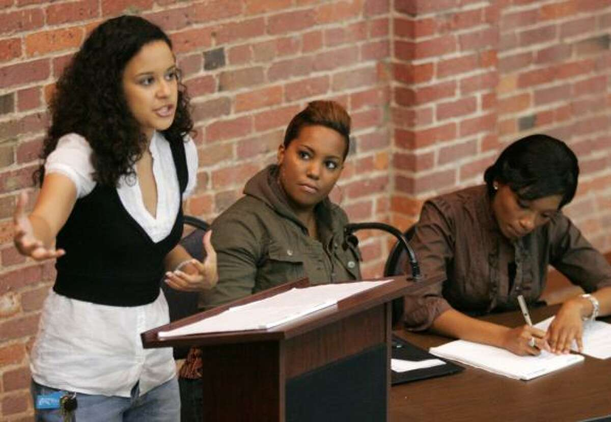 From left, Megan Moten presents her argument during a practice with Caress Russell and Keisha Coleman of the Wiley College debate team. The film