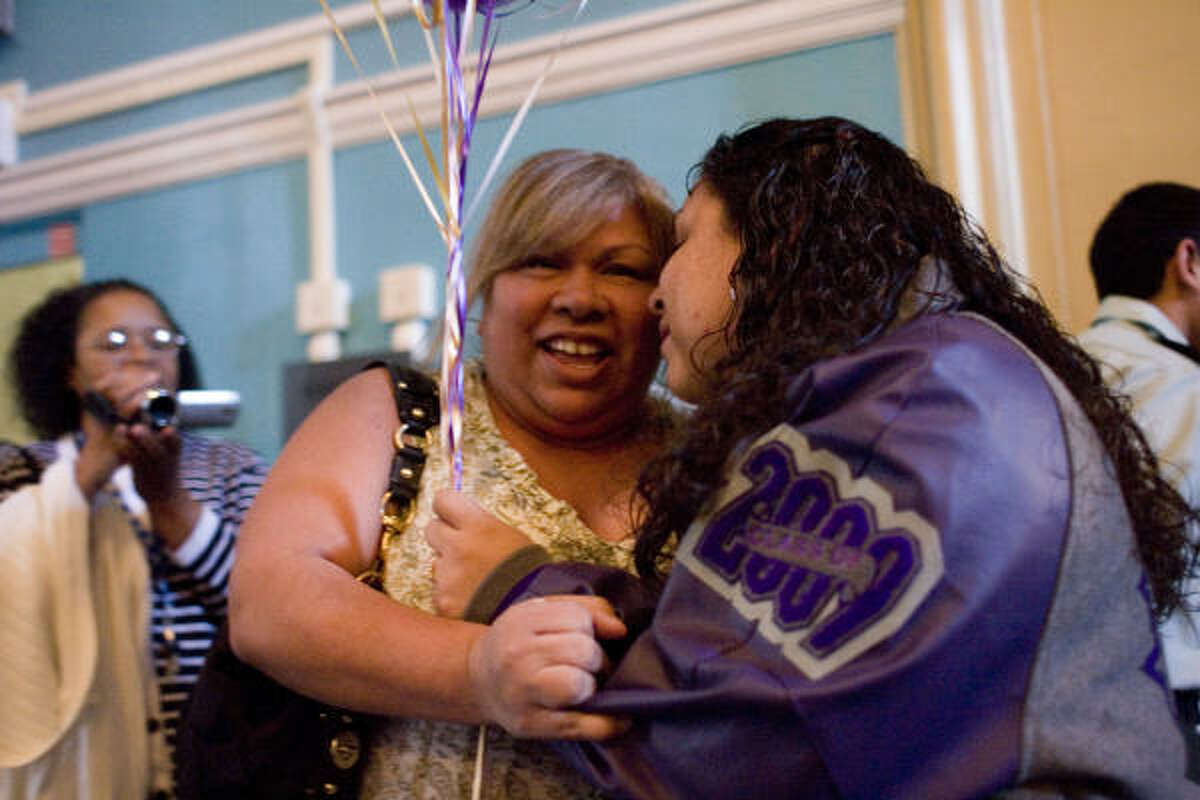 Evelyn Sotelo, left, is proud of her daughter Selena, 18, as Davis High School honored its top students at the school's annual Academic Letter Jacket program on Friday. The jacket program started in 1993.