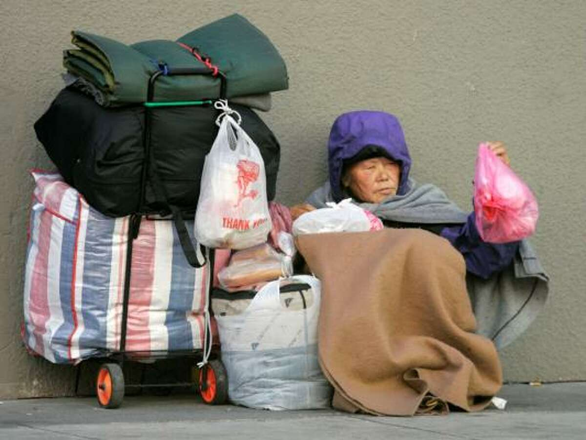 ONE OF MANY: It will be months before officials know how many individuals are homeless, like this woman living on the streets of San Francisco.