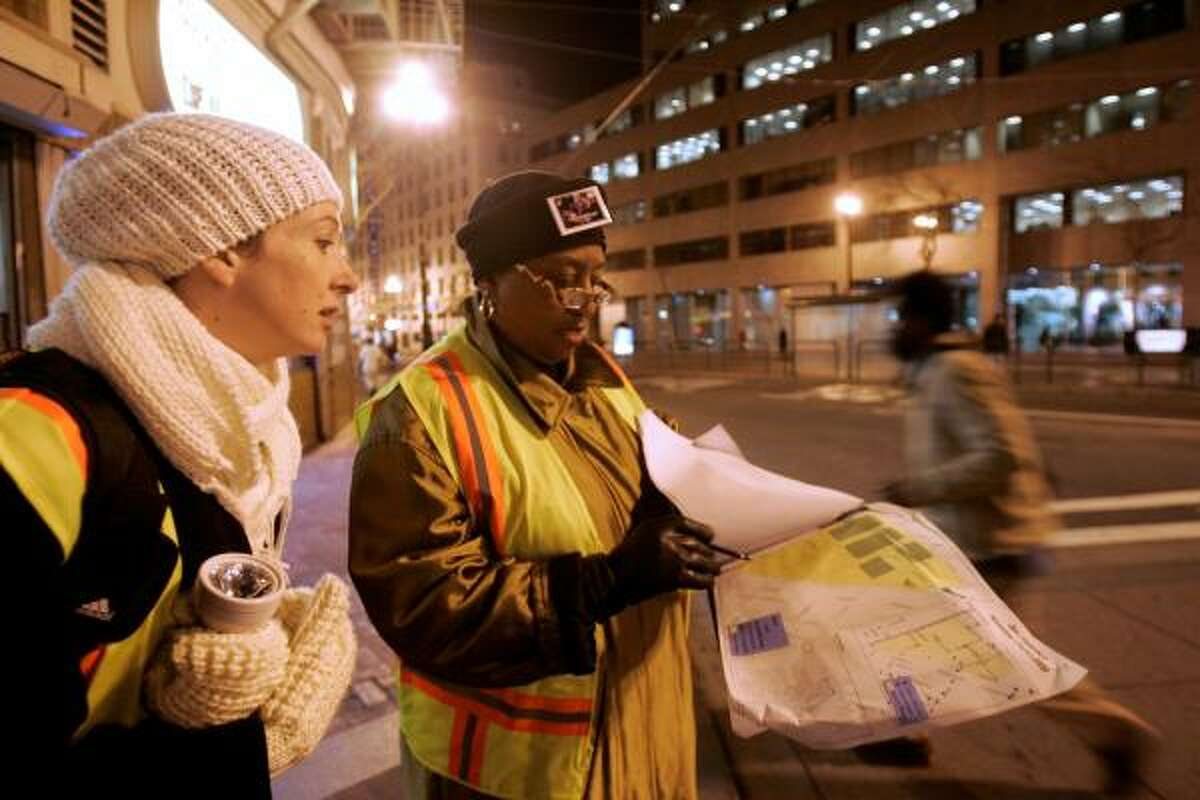 City workers Christine Von Aken, left, and Joyce Crum participate in a homeless count in San Francisco.