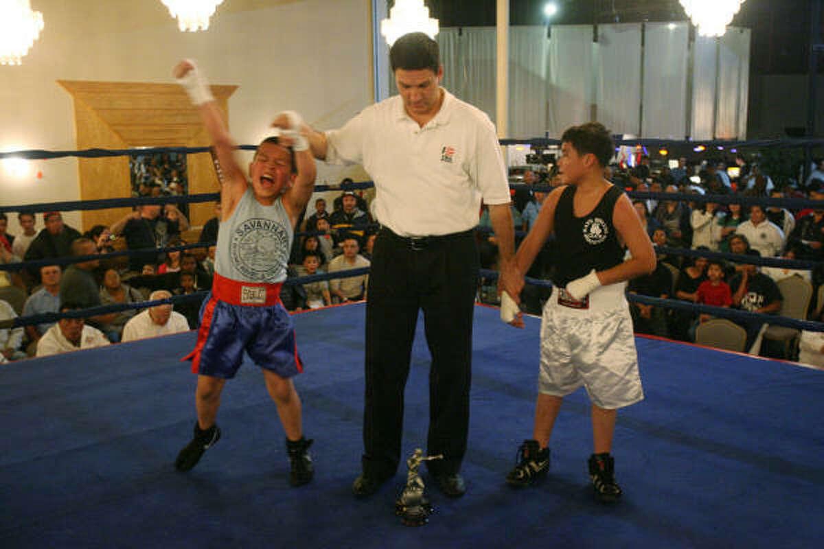 Raphael Medina, Jr., of Savannah Boxing Club, beats Gustavo Guerrero of Ray's Boxing Club.