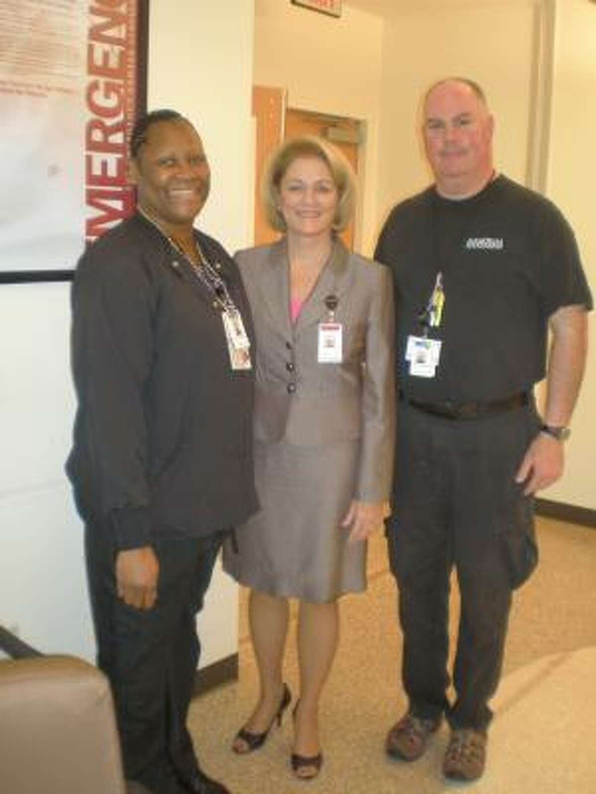 THE NEW BOSS: Carolyn Galloway, center, is the new Emergency Center Medical Director at Northeast Hospital. She is shown here with two Emergency Center employees, Alvin Perry, left, and Keith Bailey.