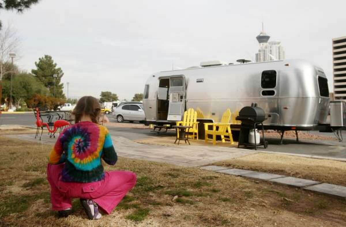 Emma Luhr, 8, plays outside an Airstream trailer at a Kampground of America in Las Vegas. KOA has purchased 25 of the trailers and will offer them for rent at three of its campgrounds.