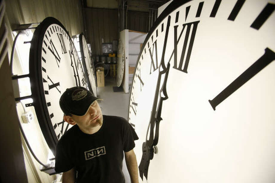 Clocks are tested at Electric Time Co. in Medfield, Mass. They'll be adjusted Sunday, along with timekeepers in 48 U.S. states. Photo: Stephan Savoia, AP