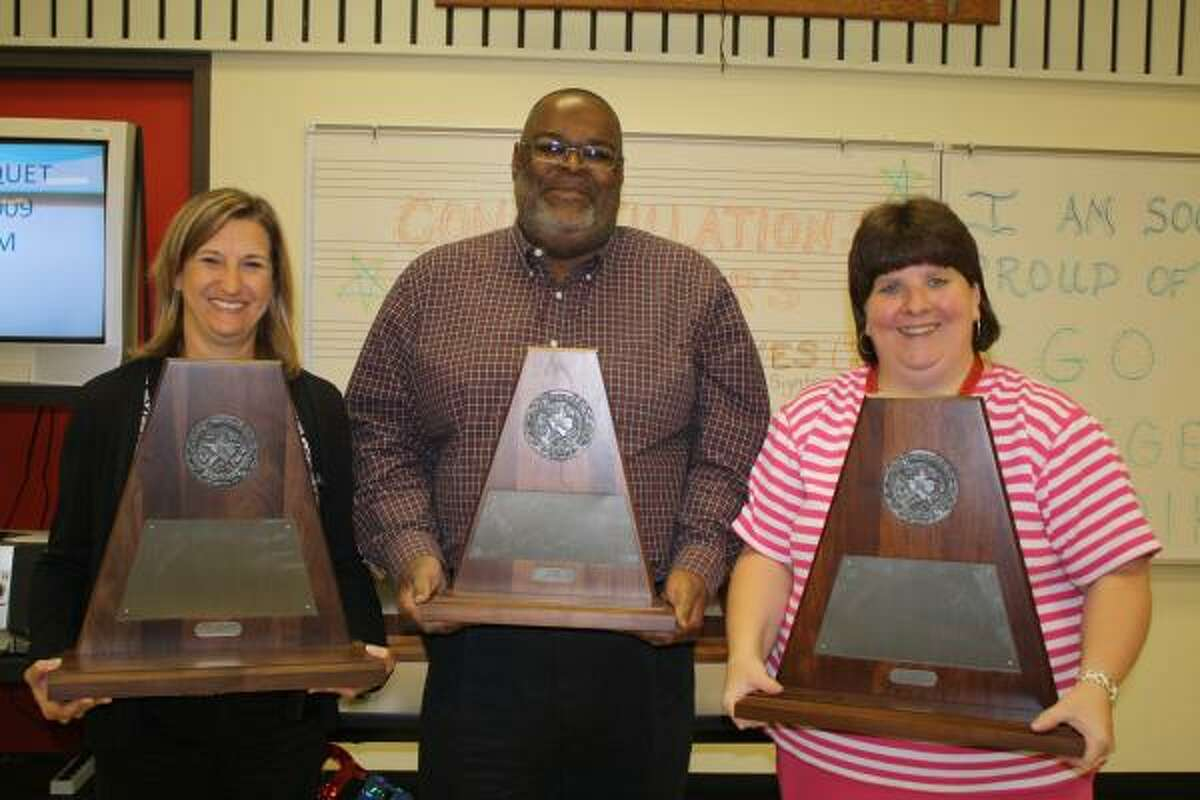 B.F. Terry High School Principal Vera Wehring, left, holds one of the University Interscholastic League Sweepstakes awards the Terry High band earned at competition. She is joined by Tim Taylor, Terry band director, and Rhonda Klutts, Terry choral director. This year, the band earned straight 1's, the highest ranking, across the board in the concert and sight reading contest. The varsity choir earned straight 1's for the first time to clinch the honor and earned the Sweepstakes award for the fourth consecutive year, making history at the school.
