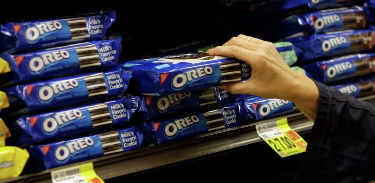 FILE - In this Feb. 9, 2011 file photo, a shopper selects Oreo cookies by Nabisco - part of the Kraft Foods Inc. family of brands and products, are seen at a Ralphs Fresh Fare supermarket in Los Angeles. Kraft Foods Inc. said Thursday, Aug. 4, 2011, that it plans to split into two publicly traded companies, with one concentrating on snacks like Oreo cookies, Trident gum and Cadbury chocolates while the other focuses on the North American grocery business which include Kraft cheese and Maxwell House coffee. (AP Photo)